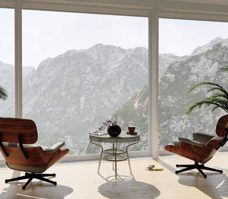 תמונה של חדר מנוחה פונה לנוף הרים ירוק